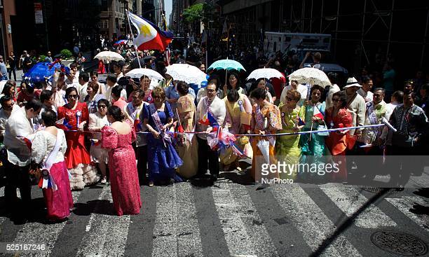 The members of the Philippine Independence Day Commission cuts the ribbon to start the parade along madison Ave At the 116th year celebration of the...