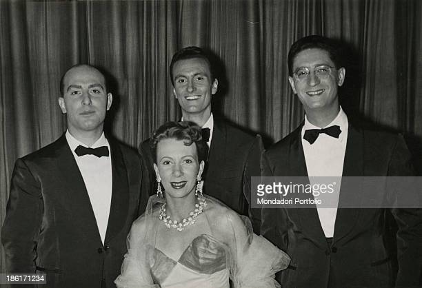 The members of the Quartetto Cetra smiling in evening clothes The band is formed by Italian singer and drummer Felice Chiusano Italian singer and...