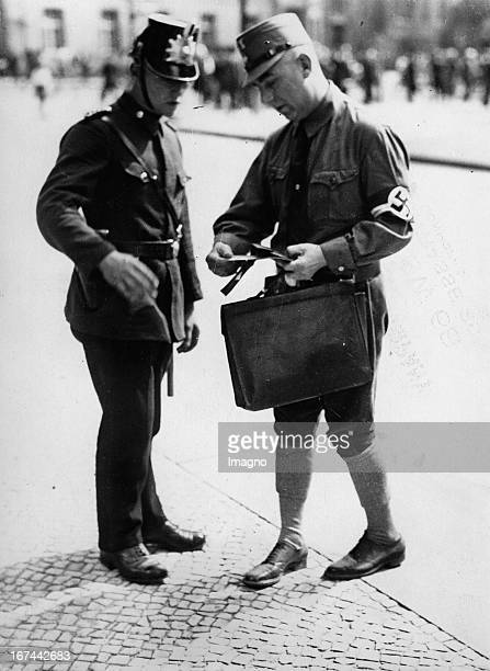 The members of the Reichstag have to identify themselves before entering the Reichstag in Berlin. About 1933. Photograph. Die Reichstagsabgeordneten...