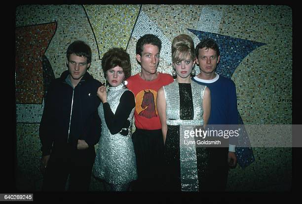The members of the rock/new wave group the B-52s pose in front of a mosaic wall. From left to right: Keith Strickland, drums; Kate Pierson, keyboards...