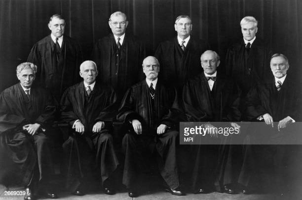 The members of the Supreme Court including Chief Justice Charles Evans Hughes who defied President Franklin Delano Roosevelt's attempts to remove...