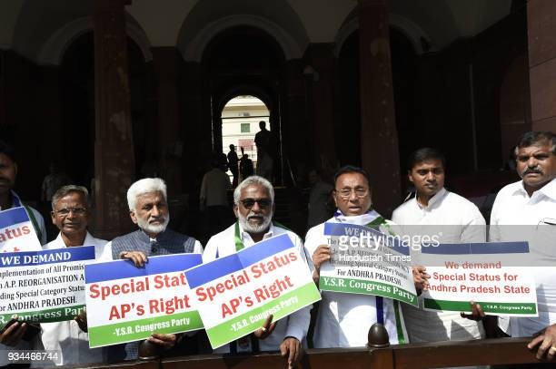 The members of YSR party stage protest demanding special status for Andhra Pradesh during the Budget Session of Parliament on March 19 2018 in New...