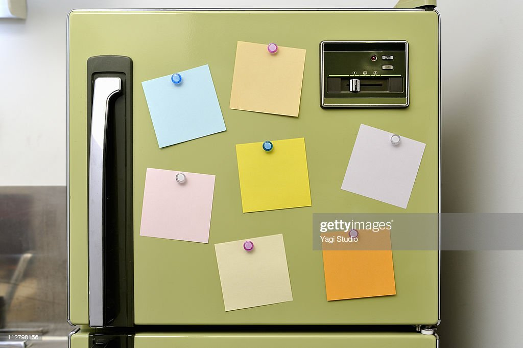 The memo fastened to the refrigerator with the mag : Stock Photo