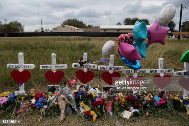 The memorial crosses for the victims of the Sutherland Springs First Baptist Church shooting stand covered in flowers gifts and notes in Sutherland...