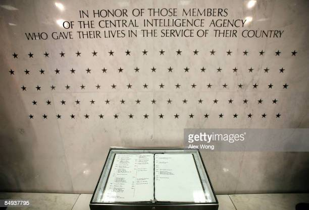 """The Memorial Wall and the """"Book of Honor"""" are seen in the lobby of the Original Headquarters Building at the Central Intelligence Agency headquarters..."""