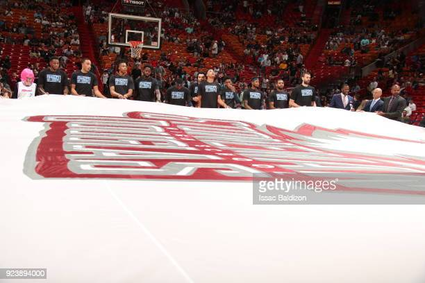 the Memphis Grizzlies hold the Marjory Stoneman Douglas HS flag prior to the game against the Miami Heat on February 24 2018 at American Airlines...