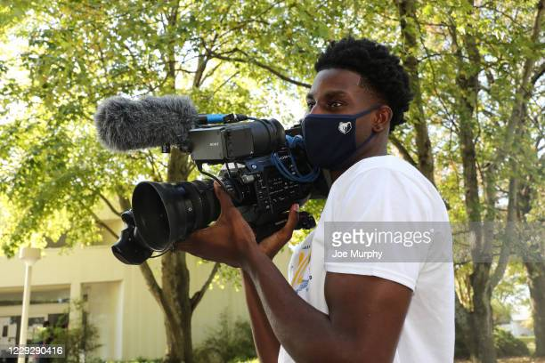 The Memphis Grizzlies host an early Voting Event with Jaren Jackson Jr #13 holding a camera at Agricenter International on October 21 2020 in Memphis...