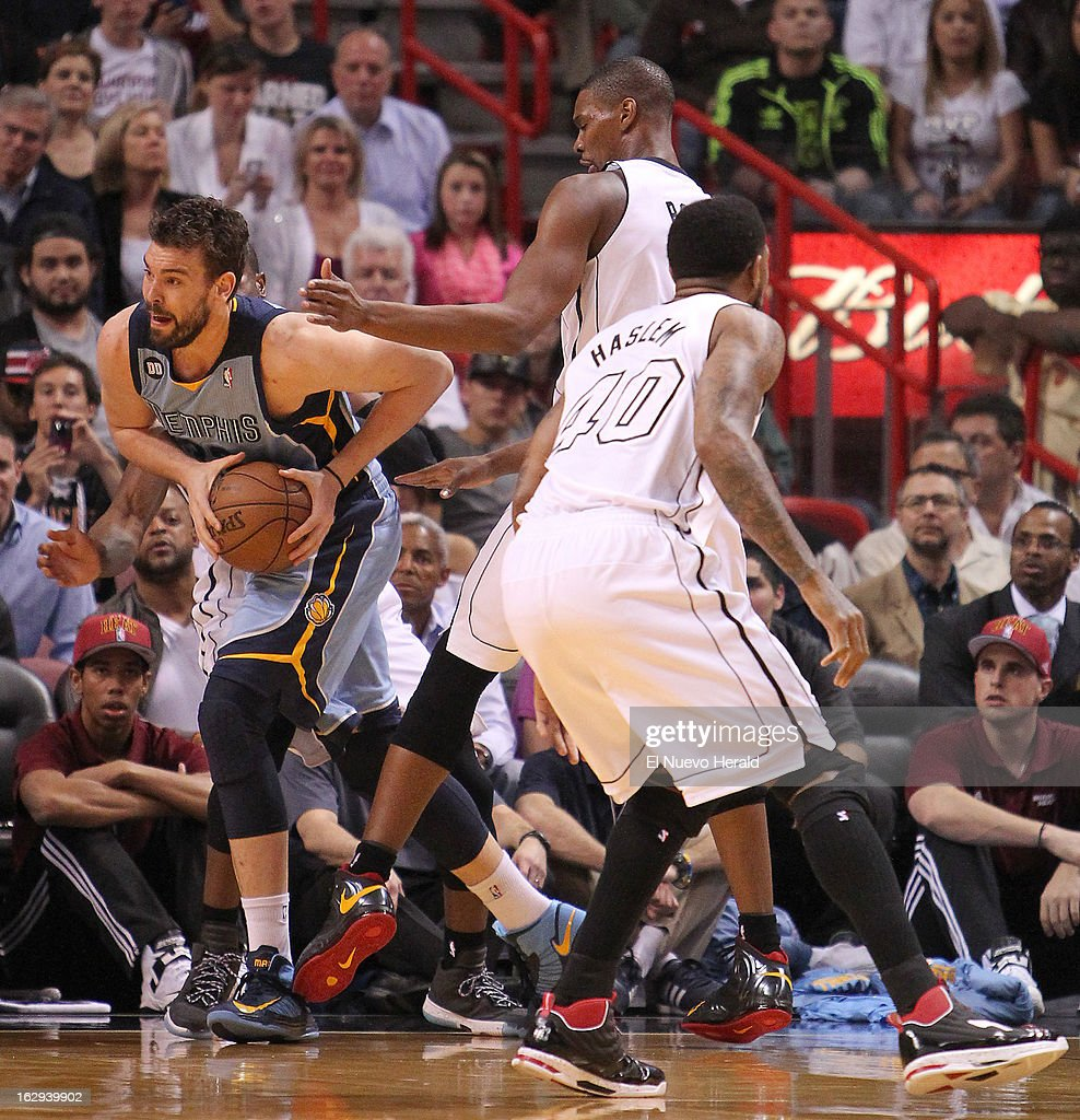 The Memphis Grizzlies' Marc Gasol, left, drives against the Miami Heat's Dwyane Wade, Chris Bosh, top, and Udonis Haslem, right, during the first quarter at the AmericanAirlines Arena in Miami, Florida, on Friday, March 1, 2013.