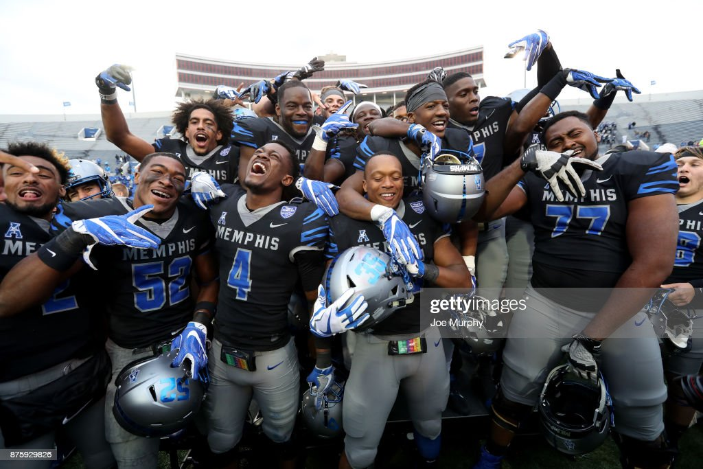 The Memphis Tigers celebrate after defeating the SMU Mustangs on November 18, 2017 at Liberty Bowl Memorial Stadium in Memphis, Tennessee. Memphis defeated SMU