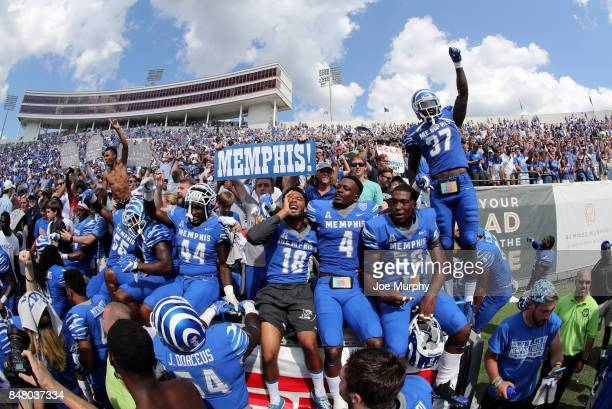 The Memphis Tigers celebrate their victory with fans against the UCLA Bruins on September 16 2017 at Liberty Bowl Memorial Stadium in Memphis...