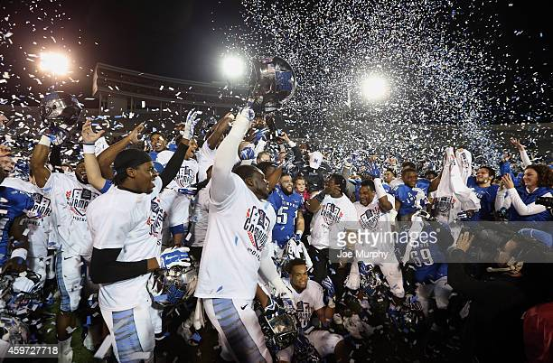The Memphis Tigers celebrate winning the AAC after a game against the Connecticut Huskies on November 29, 2014 at Liberty Bowl Memorial Stadium in...
