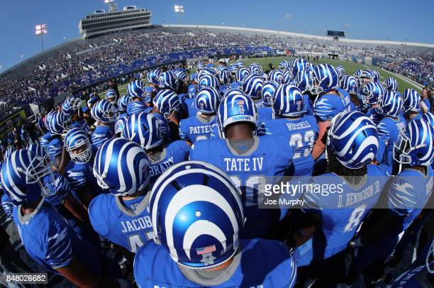 The Memphis Tigers huddle before the game against the UCLA Bruins on September 16 2017 at Liberty Bowl Memorial Stadium in Memphis Tennessee Memphis...