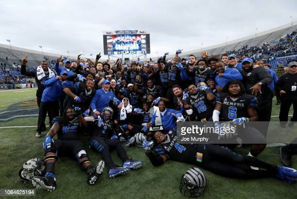 The Memphis Tigers pose for a photo with the AAC West Division trophy against the Houston Cougars during the second half on November 23, 2018 at...