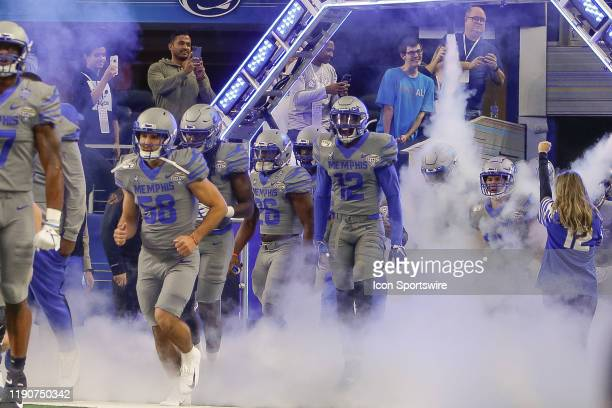 The Memphis Tigers run onto the field prior to the Cotton Bowl Classic between the Memphis Tigers and Penn State Nittany Lions on December 28, 2019...