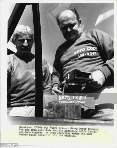 The men from Auto Code Vehicle Engraving Colin Cahill and John Rugless at work engraving the cars number plate number to all the windows August 26...