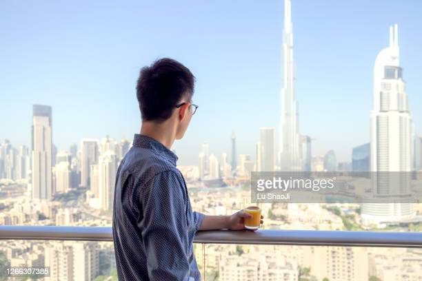 the men looking at the urban skyline and cityscape in dubai. - united arab emirates stock pictures, royalty-free photos & images