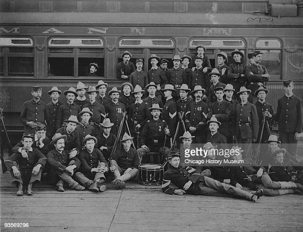 The men of Company D of the Illinois National Guard poses for a group portrait while stationed in the Pullman Yards during the Pullman strike Chicago...