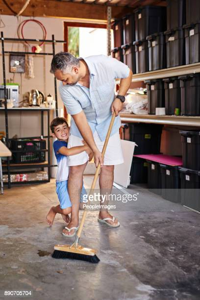 the men of the house working in the garage - sweeping stock pictures, royalty-free photos & images