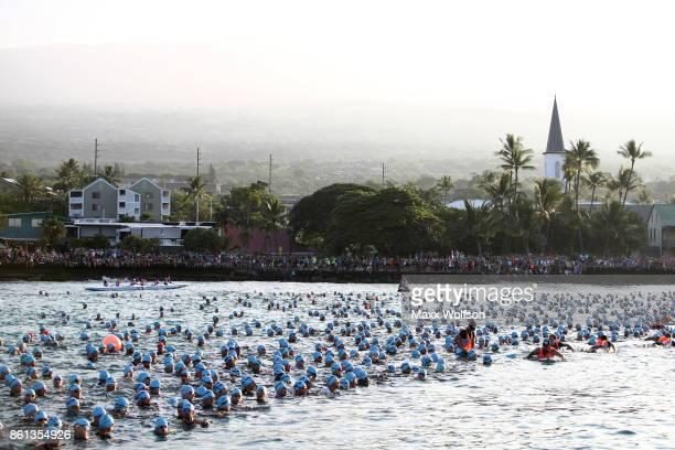 The men wait for the start of the men's mass start during the IRONMAN World Championship on October 14 2017 in Kailua Kona Hawaii