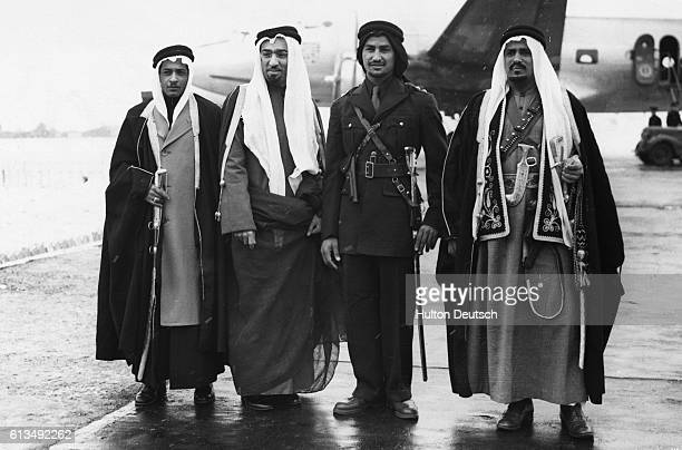 The men who protect Emir Saud the crown prince of Saudi Arabia arrive at Bovington airfield for the prince's visit to Britain | Location Bovington...