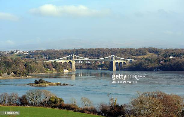 The Menai Suspension Bridge between the island of Anglesey and the mainland of Wales is pictured on March 25 2011 The island of Anglesey has about as...