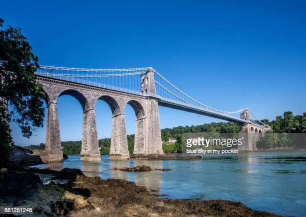 the menai suspension bridge, built in 1826 by thomas telford. - menai straits stock pictures, royalty-free photos & images