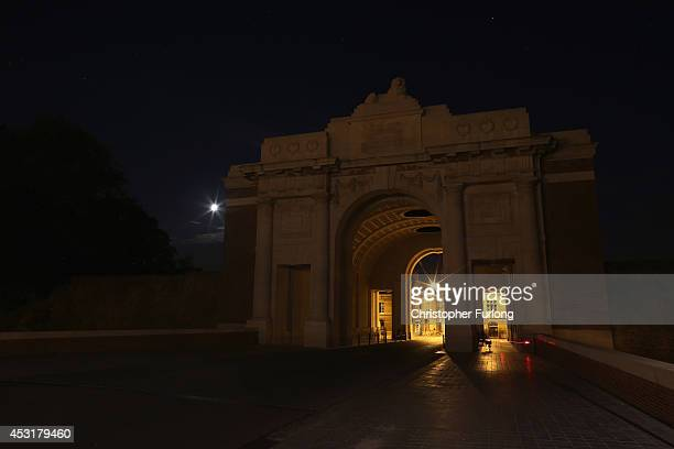The Menin Gate Memorial to the Missing sits in near darkness as the lights that normally illuminate it are turned off during a symbolic 'lights Out'...