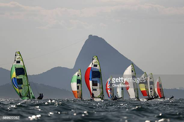 The mens 49er fleet head downwind towards Sugarloaf Mountain on Day 10 of the Rio 2016 Olympic Games at the Marina da Gloria on August 15 2016 in Rio...