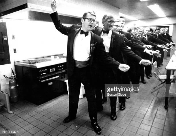 The men's chorus line practices in a kitchen off of the dressing room for the annual Vincent Club show titled 'Fit to Print' to benefit the Vincent...