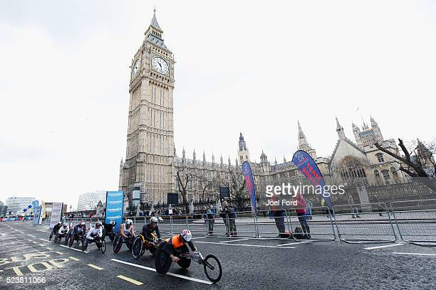 The Men's Elite wheelchair lead group head past Big Ben during the Virgin Money London Marathon on April 24 2016 in London England