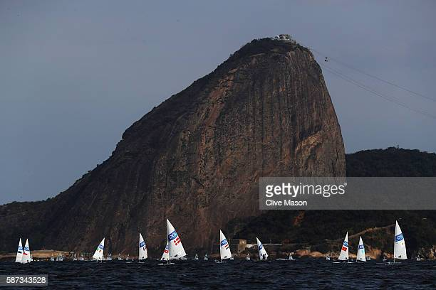 The Men's Laser fleet during Race 1 on Day 3 of the Rio 2016 Olympic Games at Marina da Gloria on August 9 2016 in Rio de Janeiro Brazil