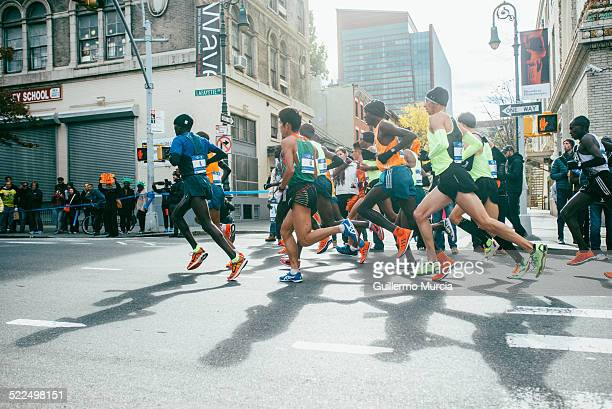 The men's leading group passes by Lafayette Avenue in Fort Greene Brooklyn