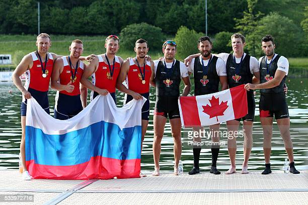 The Men's Quadruple Sculls teams of Russia and Canada pose for a photo after qualifying for the 2016 Summer Olympic Games in Rio during Day 3 of the...