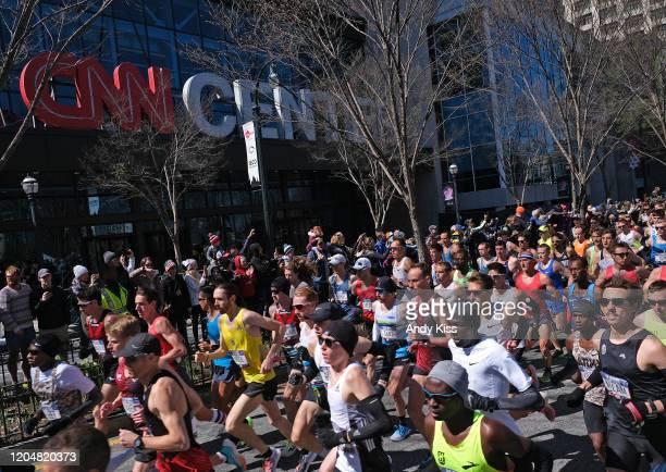 The men's race runs past the CNN Center at the start of the US Olympic marathon team trials on February 29 2020 in Atlanta Georgia