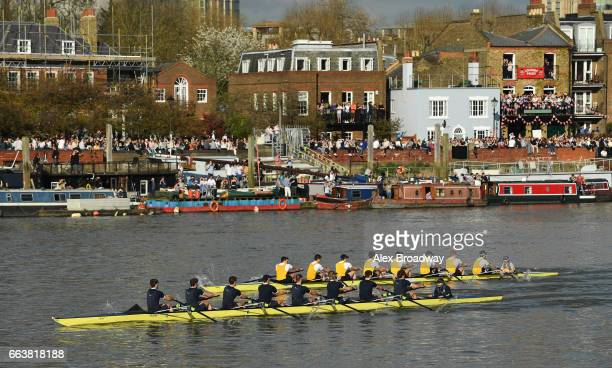 The Men's Reserve Boats Race pass under Hammersmith Bridge during The Cancer Research UK Boat Race on April 2 2017 in London England The 163rd annual...