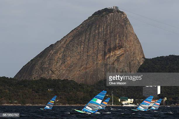 The Men's RSX fleet during Race 2 on Day 3 of the Rio 2016 Olympic Games at Marina da Gloria on August 9 2016 in Rio de Janeiro Brazil