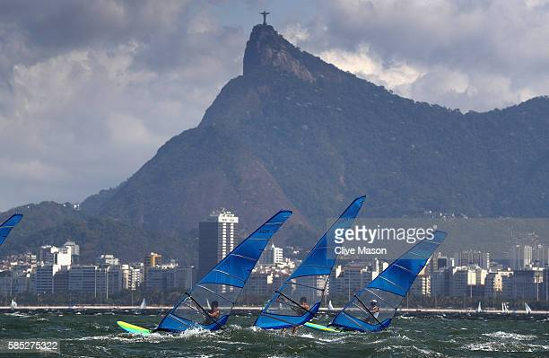 The mens RSX fleet in action training against the backdrop of Christ The Redeemer during training ahead of the Rio 2016 Olympic Games at the Marina...