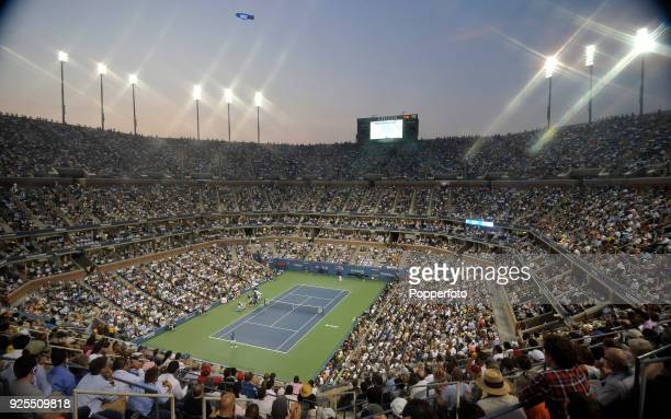 The Men's Singles Final in progress between Novak Djokovic of Serbia and against Rafael Nadal of Spain at dusk on Day Fifteen of the 2011 US Open at...