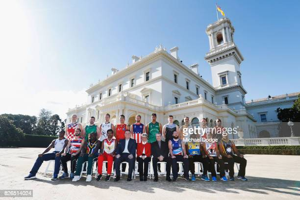 The Mens team captains pose together with Honourable Linda Dessau AC Governor of Victoria her husnand Tony Howard and John Eren Sport Minister during...