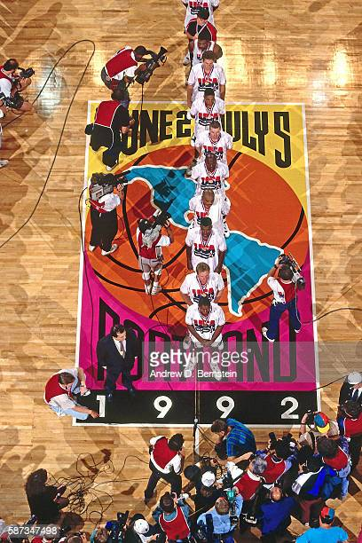 The Men's United States Olympic gold medal winning basketball team poses for a photo on the court at the 1992 Basketball Tournament of the Americas...