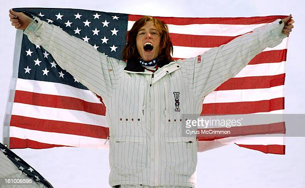 The mens Winter Olympic snowboard half pipe contest . American Shaun White of Carlsbad, CA winner of the the gold medal lets out a whoop of joy as he...