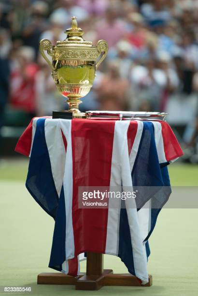 The Mens's Singles trophy stands on a union flag covered table waiting to be presented to Roger Federer on day thirteen of the Wimbledon Lawn Tennis...
