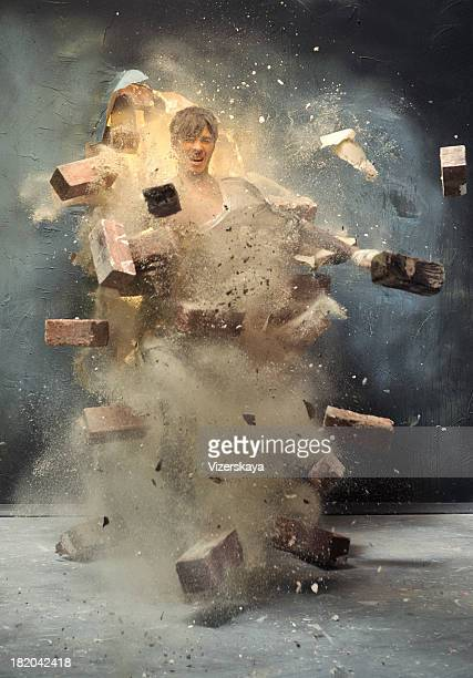 the men\tthrough broken wall - demolishing stock pictures, royalty-free photos & images