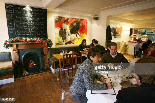 The menu is written on a chalkboard above the fireplace at The Bull during lunch in London UK Wednesday December 20 2006 When Sebastian Wilson...