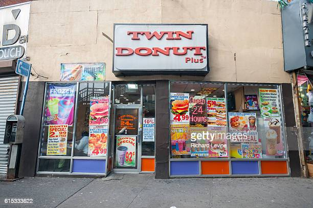 The menu of a Twin Donut Plus cafe is plastered all over the windows in the Fordham Road shopping district in the Bronx in New York on Thursday...