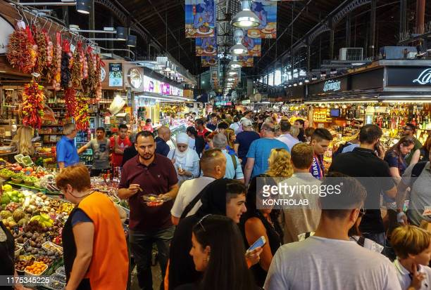 The Mercat de Sant Josep, better known as La Boqueria, is full of shoppers and tourists, located in Barcelona, Spain.