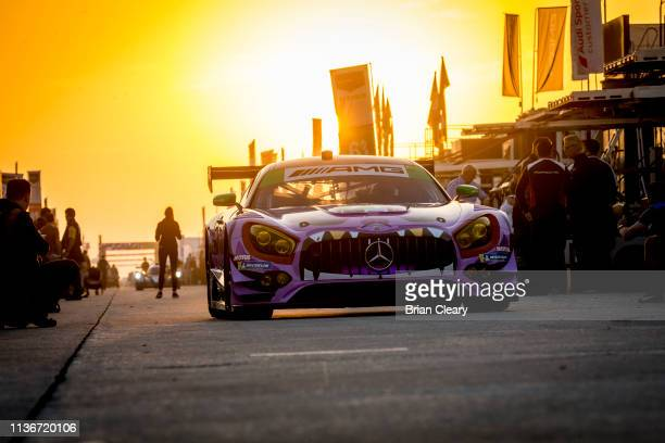 The Mercedes AMG GT3 of J.C. Perez, of Colombia, Maximillian Buhk, of Germany, and Fabian Schiller, of Germany, drives through the paddock for early...