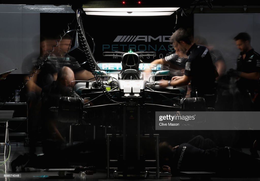 The Mercedes AMG team work on the car of Lewis Hamilton of Great Britain and Mercedes GP in the garage after qualifying for the Formula One Grand Prix of Japan at Suzuka Circuit on October 7, 2017 in Suzuka.