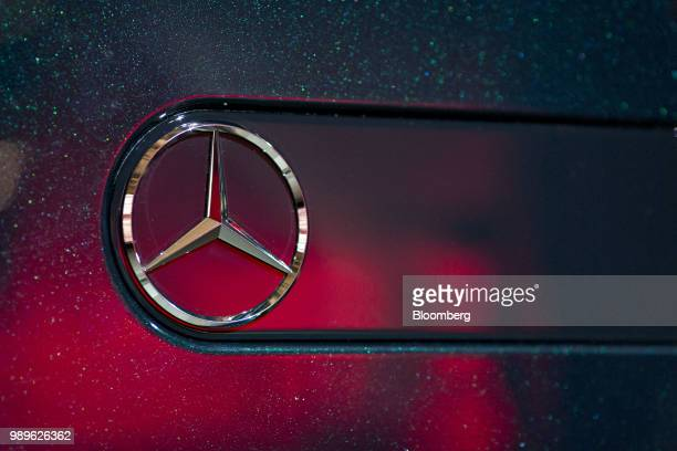 The Mercedes Benz AG logo sits on a Daimler AG MercedesBenz GClass vehicle as it sits on display during its debut at an event during the 2018 North...