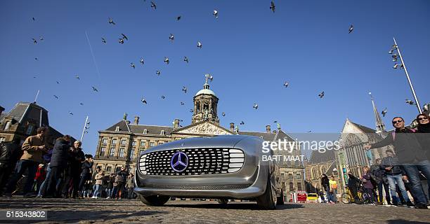 The Mercedes Benz F 015 selfdriving stands on March 13 2016 at the Dam square in Amsterdam This model is presented for the first time in Europe / AFP...